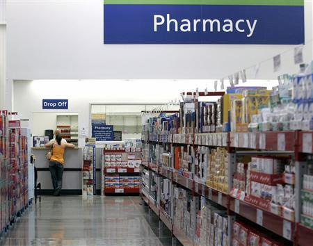 A customer leans against a pharmacy counter in a file photo. REUTERS/Jessica Rinaldi