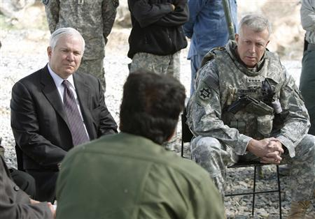 U.S. Secretary of Defense Robert Gates and U.S. Army General David McKiernan, the top U.S. and NATO Commander in Afghanistan (R) listen to Afghan governors and local officials during their visit to Forward Operating Base Airborne in the mountains of Wardak Province, Afghanistan, May 8, 2009. REUTERS/Jason Reed
