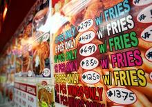 <p>A menu for fried chicken and french fries is displayed on a wall at a fast food restaurant in New York, October 30, 2006. REUTERS/Shannon Stapleton</p>