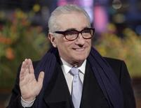 <p>U.S. director Martin Scorsese waves at the red carpet as he arrives for the screening of his opening film 'Shine A Light' running in competition at the 58th Berlinale International Film Festival in Berlin February 7, 2008. REUTERS/Hannibal Hanschke</p>