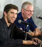 <p>Swimmer Michael Phelps (L) answers questions as his personal coach Bob Bowman looks on during a news conference at the Mecklenburg Aquatic Center in Charlotte, North Carolina May 14, 2009 . REUTERS/Chris Keane</p>