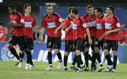 <p>Jogadores do Real Mallorca comemoram gol da sua vitória contra o Barcelona. 17/05/2009. REUTERS/Dani Cardona</p>