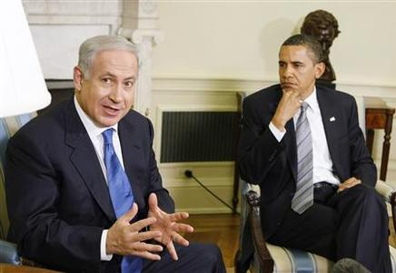 President Barack Obama listens as Israeli Prime Minister Benjamin Netanyahu speaks in the Oval Office of the White House in Washington May 18, 2009. REUTERS/Larry Downing