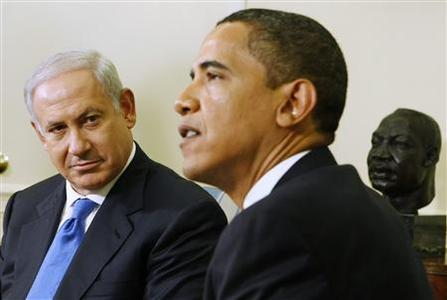 Israeli Prime Minister Benjamin Netanyahu (L) listens as U.S. President Barack Obama speaks in the Oval Office of the White House in Washington May 18, 2009. Obama voiced support for creation of a Palestinian state in talks on Monday with Netanyahu, who held back from endorsing the main cornerstone of Washington's Mideast policy. REUTERS/Larry Downing