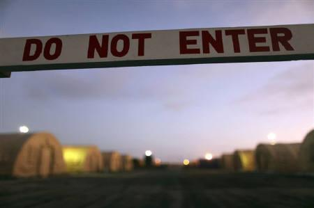 In this January 19, 2009 file photo, reviewed by the U.S. Military, a sign marks a closed-off area at Camp Justice, the location of the U.S. Military Commissions court for war crimes, at the U.S. Naval Base, in Guantanamo Bay, Cuba. REUTERS/Brennan Linsley/Pool/Files