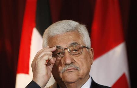 Palestinian President Mahmoud Abbas adjusts his glasses during a news conference with Canada's Foreign Minister Lawrence Cannon (not pictured) at the Lester B. Pearson building in Ottawa May 25, 2009. REUTERS/Chris Wattie