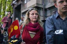 <p>Christiania residents stand outside the Copenhagen High Court May 26, 2009. REUTERS/Jens Noergaard Larsen/Scanpix</p>