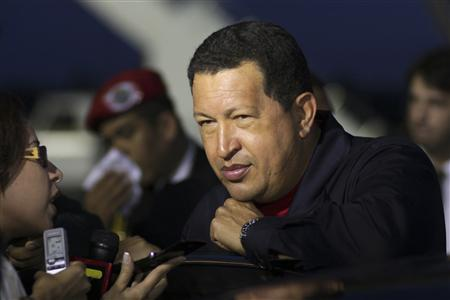 Venezuela's President Hugo Chavez talks to the media after his arrival at Salvador City, capital of the northeastern state of Bahia May 26, 2009. REUTERS/Juan Carlos Solorzano/Miraflores Palace/Handout