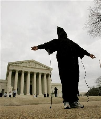 An activist takes part in a demonstration against 'American violations of international human rights' at Abu Ghraib prison in Iraq, in front of the U.S. Supreme Court, in a 2005 photo. REUTERS/Larry Downing