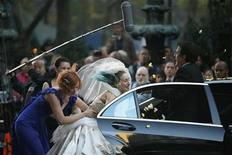 "<p>Actress Sarah Jessica Parker (C) is held back by co-star Cynthia Nixon (L) as she hits actor Chris Noth with a wedding bouquet as they film a scene on the set of ""Sex and the City:The Movie"" in New York October 12, 2007. REUTERS/Brendan McDermid</p>"