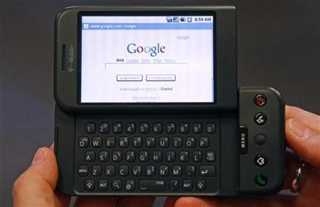 A woman holds a Google T-Mobile G1 mobile telephone in New York City, October 22, 2008. REUTERS/Mike Segar
