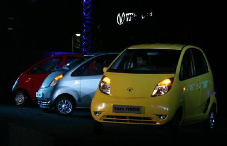 Tata Motors 'Nano' cars are displayed during their launch in Mumbai March 23, 2009. REUTERS/Punit Paranjpe/Files