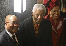 <p>Former South African President Nelson Mandela (C) and his wife Graca Machel (R) talk to President Jacob Zuma after the state-of-the-nation address in Parliament, Cape Town June 3 2009. REUTERS/Mike Hutchings</p>