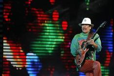 <p>Mexican guitarist Carlos Santana performs during the 50th International Song Festival in Vina Del Mar city, about 75 miles (120 km) northwest of Santiago February 25, 2009. REUTERS/Eliseo Fernandez</p>