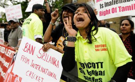 Tamil supporters demonstrate outside the grounds during the ICC World Twenty20 warm-up cricket match between Sri Lanka and South Africa at Lord's Cricket Ground in London June 3 2009. REUTERS/Philip Brown