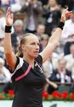 <p>Russa Svetlana Kuznetsova comemora vitória sobre Dinara Safina no Aberto da França. REUTERS/Vincent Kessler</p>