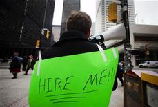 <p>A man with a sign on his back uses a megaphone to attract the attention of potential employers as he hands out resumes in the financial district in Toronto, March 5, 2009. REUTERS/Mark Blinch</p>