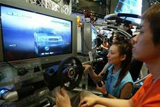 <p>Videogiocatori in azione. REUTERS</p>