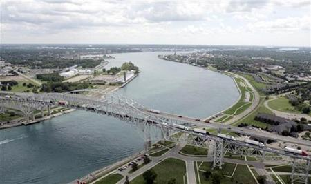 The Bluewater bridge is seen, joining the U.S (L) and Sarnia, Canada, from a U.S. Customs and Border Protection Blackhawk helicopter in Port Huron, Michigan August 6, 2008. REUTERS/Rebecca Cook