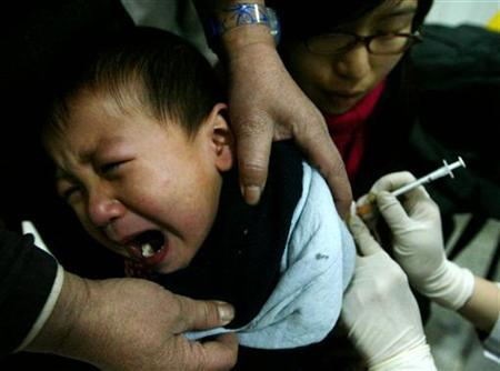 A Chinese child receives vaccination against meningitis at a disease prevention station in Beijing February 3, 2005. REUTERS/Jason Lee