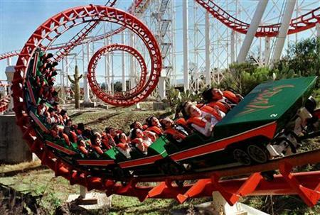 Rebecca Harris and Rocky Villarma (front row) of Los Angeles ride the Viper rollercoaster on which they were married at Six Flags Magic Mountain in Santa Clarita, February 12, 1999. REUTERS/File