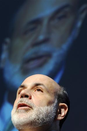 Federal Reserve Chairman Ben Bernanke's image is projected behind him as he addresses the HOPE Global Financial Literacy Summit at a community center in Washington, June 17, 2009. REUTERS/Jonathan Ernst