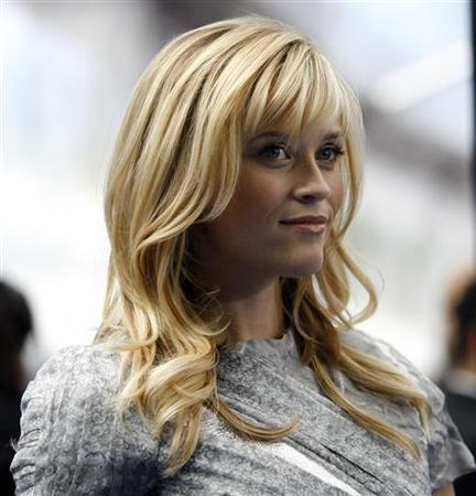 Actress Reese Witherspoon, who gives voice to Ginormica in the movie, poses at the premiere of ''Monsters vs. Aliens'' at the Gibson amphitheatre in Universal City, California, March 22, 2009. REUTERS/Mario Anzuoni