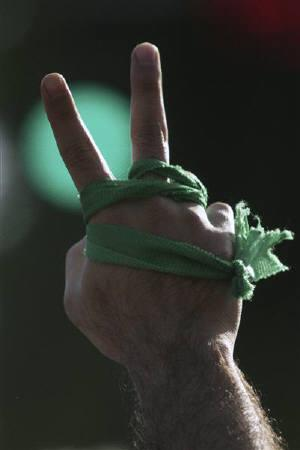 A supporter of defeated Iranian presidential candidate Mirhossein Mousavi gestures while attending a rally in Tehran June 17, 2009. REUTERS/Demotix