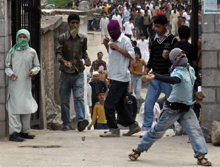 Kashmiri protesters throw stones and pieces of bricks towards Indian policemen during a protest over the alleged rape and murder of two Muslim women, in Srinagar, June 19, 2009. REUTERS/Umar Ganie