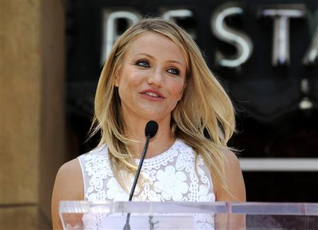 Cameron Diaz speaks at a ceremony where the actress receives a star on the Hollywood Walk of Fame in Los Angeles June 22, 2009. REUTERS/Phil McCarten
