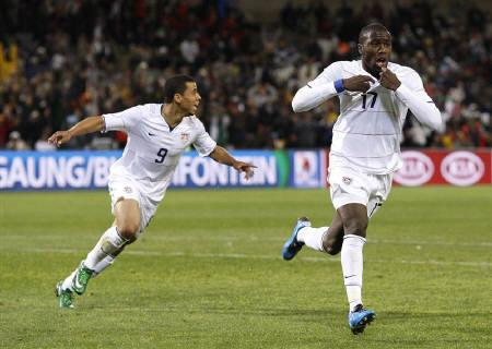Jozy Altidore of the U.S. (R) celebrates with team mate Charlie Davies after scoring a goal during their Confederations Cup semi-final soccer match against Spain at the Free State Stadium in Bloemfontein, June 24, 2009. REUTERS/Jerry Lampen