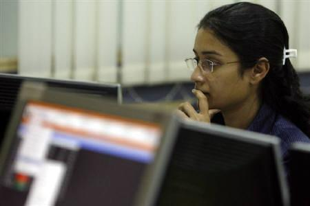 A broker looks at her computer terminal at a stock brokerage firm in Mumbai in this May 2009 file photo.  Sun Pharmaceutical shares plunged as much as 17.6 percent on Friday, their biggest intra-day drop, a day after U.S. authorities seized drugs made by its U.S. unit for manufacturing-standards violations. REUTERS/Punit Paranjpe