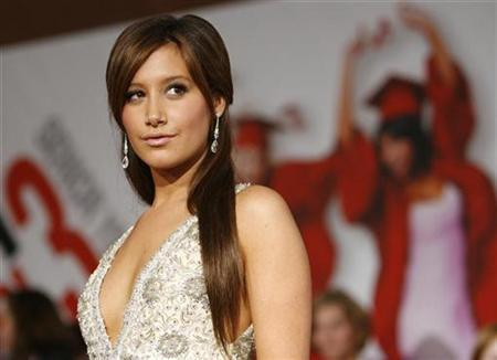 Cast member Ashley Tisdale poses at the premiere of the movie ''High School Musical 3: Senior Year'' at Galen Center in Los Angeles October 16, 2008. REUTERS/Mario Anzuoni
