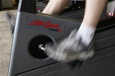 <p>A client pedals an exercise bike at the Bally Total Fitness facility in Arvada, Colorado June 15, 2009. REUTERS/Rick Wilking</p>