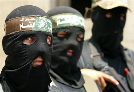 Hamas gunmen take part in a news conference in Gaza City May 31, 2009.  REUTERS/Suhaib Salem/Files