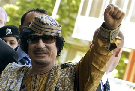 Libyan leader Muammar Gaddafi gestures as he arrives to attend a meeting at the Confindustria (Italian industry lobby) headquarters in Rome June 12, 2009. REUTERS/Tony Gentile