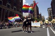 <p>Men dressed in tuxedo jackets to emulate grooms at a wedding wave flags touting their 30 years in a relationship together as a form of support for gay marriage, in the annual Gay Pride Parade in New York June 28, 2009. REUTERS/Jacob Silberberg</p>