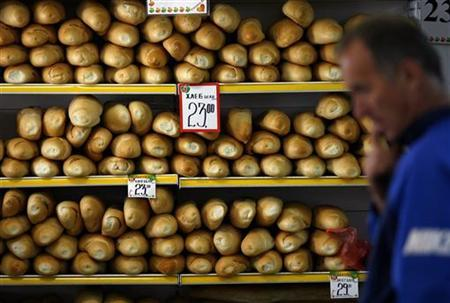 A man looks at price tags of bread in a discount supermarket in Belgrade April 22, 2009. REUTERS/Marko Djurica