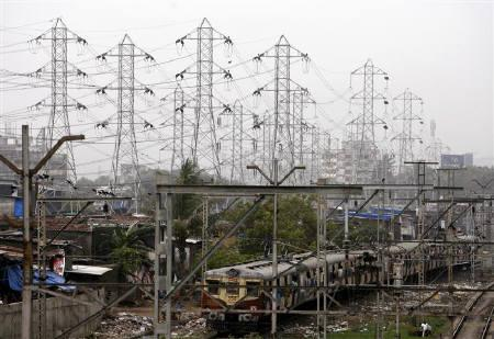 A suburban passenger train goes past high-voltage electricity towers in Mumbai June 20, 2008. India could top the list of business destinations among BRIC nations, if best practices and regulations followed by some cities are implemented by others, a report by World Bank said on Tuesday. REUTERS/Arko Datta/Files
