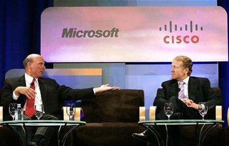Microsoft Corporation CEO Steve Ballmer (L) speaks to John Chambers, Chairman and CEO of Cisco Systems, during a panel discussion in New York August 20, 2007. REUTERS/Shannon Stapleton