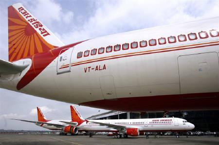 Air India's aircrafts seen at the tarmac of Mumbai airport in this July 30, 2007 file photo. REUTERS/Punit Paranjpe