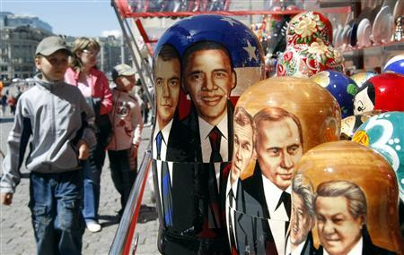 Russian Matryoshka dolls decorated with images of (L-R) Russia's President Dmitry Medvedev, U.S. President Barack Obama, former U.S. President George W. Bush, Russia's Prime Minister Vladimir Putin, former U.S. president Bill Clinton and Russia's first President Boris Yeltsin, are seen on display at a market in Moscow July 3, 2009. REUTERS/Denis Sinyakov
