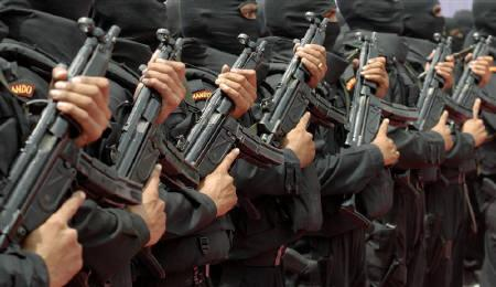 National Security Guard (NSG) commandos stand during the opening of their new hub in the southern Indian city of Hyderabad July 1, 2009. REUTERS/Krishnendu Halder