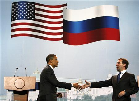 U.S. President Barack Obama and Russian President Dmitry Medvedev shake hands at the Parallel Business Summit at Manezh Exhibition Hall in Moscow, July 7, 2009. Obama said on Tuesday that Russia and the United States should promote transparency and the rule of law to ensure economic growth and investment. REUTERS/Jim Young