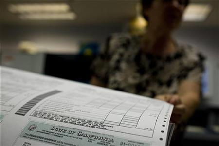 Registered warrants, or IOUs, are printed at the State Controller's office in Sacramento, California in this July 2, 2009 file photo. REUTERS/Max Whittaker