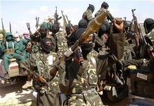 <p>Militants of al Shabaab display their weapons on the outskirts of Mogadishu, December 8, 2008. REUTERS/Feisal Omar</p>