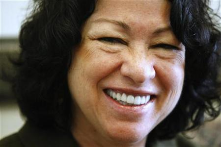 Supreme Court nominee Sonia Sotomayor smiles during her meeting with new Minnesota Senator Al Franken in his office on Capitol Hill in Washington July 9, 2009. REUTERS/Kevin Lamarque