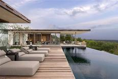 <p>The exterior of a three-bedroom villa at Alila Villas Uluwatu in Bali is seen in this handout. Singapore-based Alila Hotels and Resorts, which has properties in the Maldives, Thailand, Laos and Indonesia, is one of a handful of hoteliers in the Asia Pacific region that are leading in sustainable tourism, according to independent industry environmental advisory group EC3 Global. REUTERS/Alila/Handout</p>