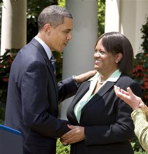 President Barack Obama shakes hand with Alabama doctor Regina Benjamin after announcing she will be the new Surgeon General while in the Rose Garden of the White House, July 13, 2009. REUTERS/Larry Downing