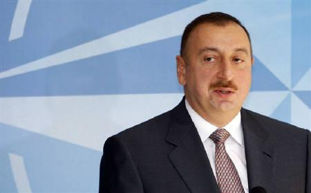 Azerbaijan's President Ilham Aliyev addresses a news conference after meeting NATO Secretary General Jaap de Hoop Scheffer (not pictured) at NATO headquarters in Brussels in this April 29, 2009 file photo.   REUTERS/Francois Lenoir/Files
